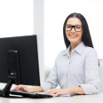 smiling businesswoman or student with eyeglasses